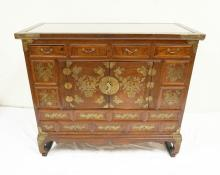 ASIAN CABINET WITH 4 DRAWERS OVER 2 DOORS. INSET GLASS TOP AND BRASS MOUNTS. 38 1/2 X 17 INCHES. 33 INCHES TALL.