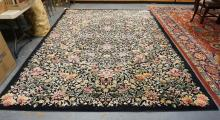 ROOM SIZE KARISTAN RUG WITH AN ALL OVER FLORAL PATTERN. 8 FT 7 IN X 12 FT