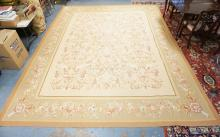 ROOM SIZE ORIENTAL RUG. FLORAL WITH A BORDER OF ROSES. 15 FT 2 INCHES X 11 FT 8 INCHES.