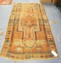 ORIENTAL RUG. 6 FT 3 INCH X 3 FT 10 INCHES. HAS WEAR.