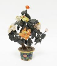 ASIAN SCULPTURE OF CARVED STONE FLOWERS IN A CLOISONNE POT. 12 INCHES TALL.