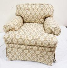 CUSTOM INTERIORS UPHOLSTERED CHAIR WITH FLOWER DECORATED PANELS.