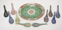 CHINESE PORCELAIN CABBAGE LEAF PLATE AND SOUP SPOONS. OVAL PLATE WITH 10 SPOONS. 3 WITH RAISED DOUBLE FISH AND KNOT DESIGN WITH VARIOUS MARKS. DISH MEASURES 11 X 8 1/2 INCH OVAL. 20TH C.