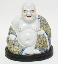 CHINESE PORCELAIN FIGURE OF BUDDAI. PAINTED WITH FAMILLE ROSE ENAMELS , MARKED ON THE BASE WITH IMPRESSED SEAL MARK. TOGETHER WITH A WOOD BASE. H 10 1/4 IN. GOOD CONDITION.