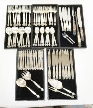 GEORG JENSEN *ACANTHUS* STERLING SILVER FLATWARE SET. SERVICE FOR 12. 81 PIECES. 97.79 TROY OZ. BREAKDOWN AVAILABLE UPON REQUEST. WEIGHT INCLUDES 1/2 TROY OZ PER KNIFE HANDLE & CARVING SET HANDLE.