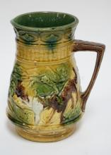 ANTIQUE MAJOLICA PITCHER W/ WOLVES HUNTING. 8 1/2 IN H