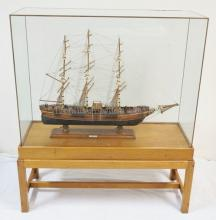 WOODEN MODEL OF THE CLIPPER SHIP *FLYING CLOUD* IN A BRASS BOUND GLASS AND WOOD CASE. OVERALL DIMENSIONS: 43 1/2 IN WIDE, 49 3/4 IN H, 16 1/2 IN DEEP