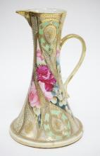 NIPPON PORCELAIN PITCHER DECORATED WITH ROSES AND HEAVY GOLD TRIM. HAS WEAR TO GOLD. UNMARKED. 10 1/4 INCHES TALL.