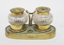 BRASS INKSTAND WITH 2 GLASS WELLS & ORNATE LIDS. 3 INCHES TALL.