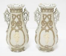 PAIR OF VILLEROY & BOCH PORCELAIN VASES WITH FIGURES IN RELIEF ON EACH SIDE. SILVER LUSTRE DECORATED (SOME WEAR). 10 INCHES TALL.