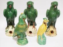 GROUP OF 5 POTTERY PARROTS. TALLEST IS 11 3/4 INCHES. THE 3 TALL ONES HAVE SOME RIM NICKS, ONE HAS RIM CHIPS AND SOME CHIPPED GLAZE ON THE BEAK.