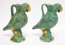 PAIR OF POTTERY PARROT DECANTERS. 10 INCHES TALL.