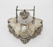 STERLING SILVER INKSTAND WITH CUT GLASS WELL. 5 7/8 INCHES WIDE. 3 7/8 INCHES TALL. WEIGHT OF STAND ALONE IS 5.7 TROY OZ.