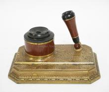 SENGBUSCH DIPADAY DESK SET WITH DECORATED BRASS BASE. 6 1/2 X 4 3/4 INCHES.