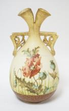 TURN TEPLITZ VASE WITH AN UNUSUAL SPLIT NECK AND TWO HANDLES. HAND PAINTED WITH FLOWERS. 7 INCHES TALL.