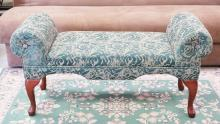 UPHOLSTERED WINDOW BENCH WITH GREEN FLORAL UPHOLSTERY. 45 INCHES LONG. 17 INCHES DEEP.