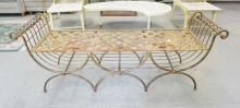 IRON WINDOW BENCH WITH A BRASS & REDDISH FINISH. 23 1/2 INCHES TALL. 64 1/4 INCHES LONG.