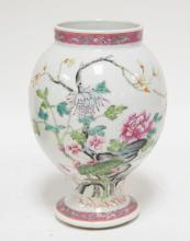 ORIENTAL PORCELAIN VASE DECORATED WITH FLOWERS. 8 INCHES TALL.