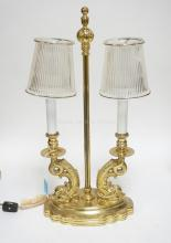 BRASS LAMP WITH 2 DOLPHIN BASED FIXTURES AND GLASS SHADES. 17 3/4 INCHES TALL.