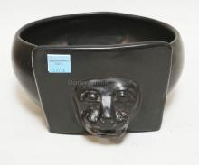 ART POTTERY BOWL WITH A LION FACE ON A FRONT PANEL. 11 INCH DIA. 6 INCHES TALL.