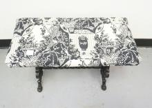 BENCH WITH A CAST IRON BASE AND AN UPHOLSTERED TOP. 25 X 12 AND 17 INCHES TALL.