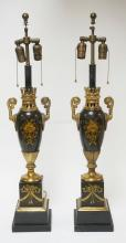 PAIR OF TOLE DECORATED METAL URN FORM LAMPS. 33 1/4 INCHES TALL. ONE LAMP HAS A SPLIT JUST BELOW THE NARROW PORTION OF THE URN AND BOTH HAVE WEAR TO THE FINISH.
