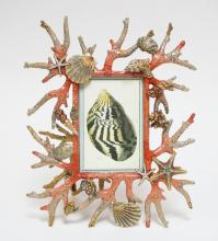 JAY STRONGWATER JEWELED AND ENAMELED PICTURE FRAME IN A MARINE LIFE MOTIF. 12 1/2 X 10 1/2 INCHES.