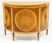 INLAID DEMI-LUNE CONSOLE CABINET BY *R.B.C. ENGLAND*. STARBURST VENEERED MEDALLION ON THE DOOR AND 2 INLAID OVAL PANELS ON THE SIDES WITH URNS. BANDED AND INLAID TOP. 48 1/2 INCHES WIDE. 37 INCHES TALL.