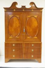 MAHOGANY ENTERTAINMENT CABINET WITH 4 DOORS AND A SHELVED INTERIOR. POCKET DOORS ON THE TOP SECTION. 84 INCHE TALL. 54 INCHES WIDE.