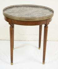 MARBLE TOP TABLE WITH A BRASS GALLERY AND FLUTED LEGS. 26 INCH DIA. 27 INCHES TALL.
