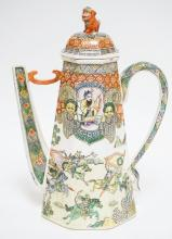 MAITLAND SMITH TEAPOT WITH AN ASIAN MOTIF. 13 INCHES TALL.