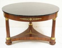 KINDEL FRENCH EMPIRE STYLE MAHOGANY TABLE WITH A MARBLEIZED TOP AND BRONZE MOUNTS. 48 INCH DIA.