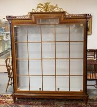 EXCEPTIONAL COLOMBO MOBILI BOOKCASE WITH ORNATE CARVED CREST INCLUDING A GOLD GILT EAGLE & EAGLET. 73 INCHES WIDE. 93 1/2 INCHES TALL.