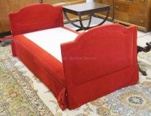 DAY BED IN RED UPHOLSTERY. 84 X 40 INCHES AND 34 1/2 INCHES TALL.