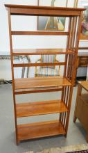 5 TIER MISSION STYLE BOOKSHELF. 63 1/2 INCHES TALL. 29 1/2 INCHES WIDE.