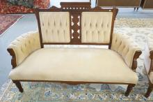 VICTORIAN CARVED WALNUT SETTEE. 59 INCHES WIDE.