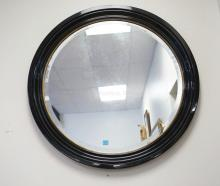 ROUND BEVELED MIRROR IN A BLACK LACQUERED FRAME. 37 1/2 INCH DIA.