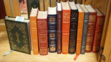 GROUP OF 11 EASTON PRESS LEATHER BOUND BOOKS WITH GOLD GILT EDGES. INCLUDES TOLSTOY, VOLTAIRE, THACKERAY, ETC.