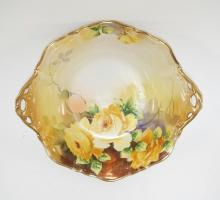 HAND PAINTED NIPPON PORCELAIN BOWL DECORATED WITH ROSES. 10 INCHES WIDE.
