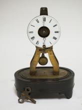 *POTON PARIS* FRENCH SKELETON CLOCK., PORCELAIN FACE HAS A HAIRLINE AND NICKS BY THE WINDER. MISSING DOME. 9 INCHES TALL.