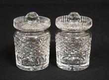 2 WATERFORD CRYSTAL CONDIMENT JARS WITH NOTCHED LIDS. 4 3/4 INCHES TALL.