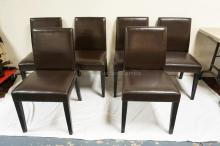 SET OF 6 LEATHER COVERED DINING CHAIRS. RETAILED AT CRATE & BARREL. 34 1/2 INCHES TALL.