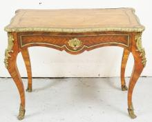 ANTIQUE FRENCH BRONZE MOUNTED ONE DRAWER DESK WITH A SLIDING FELT WRITING SURFACE OVER THE DRAWER. MATCHBOOK VENEERED WITH A BANDED TOP. 37 X 22 INCH TOP. 28 INCHES HIGH.