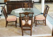 5 PIECE TABLE & CHAIR SET. INCLUDES 4 CHIPPENDALE STYLE CARVED CHAIRS WITH A CARVED CHIPPENDALE STYLE TABLE HAVING AN OCTAGONAL GLASS TOP. 55 1/2 INCHES WIDE.
