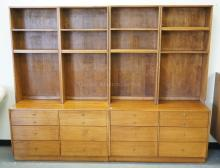 PAIR OF MID CENTURY MODERN CABINETS WITH OPEN BOOKCASE TOPS AND DRAWERS BELOW. EACH CABINET MEASURES 48 INCHES WIDE AND 76 1/2 INCHES HIGH.