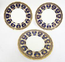 3 ROYAL DOULTON PLATES W/ ELABORATE GOLD ON COBALT BLUE BORDERS. 2 ARE MARKED TIFFANY AND CO  NEW YORK. RA8772 H625. 8 1/8 IN