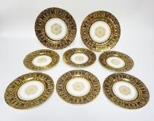 8  ROYAL DOULTON PLATES WITH ELABORATE GOLD DECORATION ON COBALT BLUE BORDERS. RA 3464, C9994. 2 ARE 10 1/2 IN, 6 ARE 8 IN. 2 OF THE SMALLER PLATES HAVE DOULTON BURSLEM MARK.