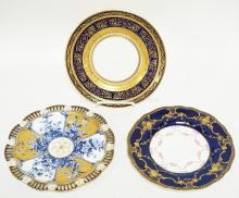 GROUP OF 3 PORCELAIN PLATES: ROYAL DOULTON FOR OVINGTON'S W/ INTRICATE GOLD DESIGN ON COBALT BLUE, COALPORT W/RETICULATED RIM AND FLORAL AND BISTO ENGLAND W/ COBALT, GOLD AND ROSES.