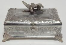 MERIDEN SILVER PLATED VICTORIAN FOOTED JEWELRY BOX W/ BIRD FINIAL. INTERIOR HA COMPARTMENTS LINED W/ SATIN AND VELVET. 10 IN X 7 IN, 6 1/2 IN H