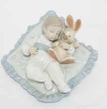 LLADRO *TAKING A SNOOZE* BOY WITH STUFFED TOY ON A PILLOW. 3 5/8 IN H